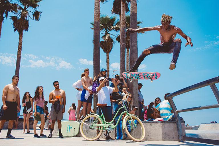 skateboarder performing tricks at Venice Beach
